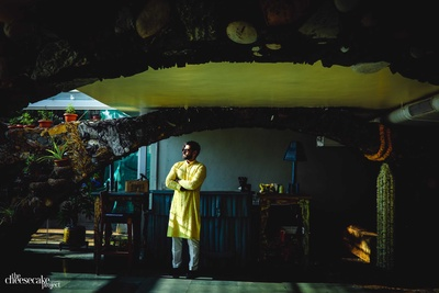 Groom poses for his pre haldi photoshoot by The Cheesecake Project