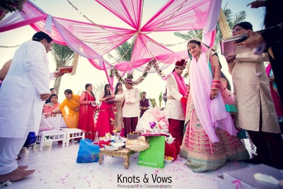 White and pink draped canopy style wedding mandap with strings of Tube roses and floral garlands