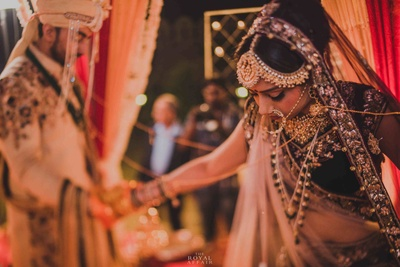The wedding ceremony proceeds in the traditional manner