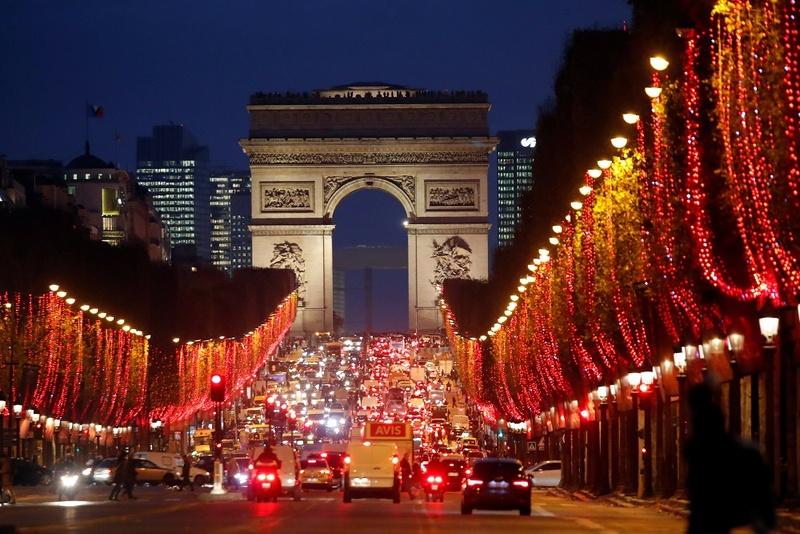 6. On the Champs Élysées, Beneath the Holiday Lights :