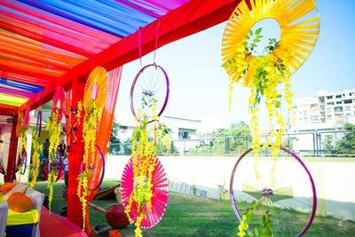 Colorful decoration for sangeet held at prasant party plot, anand