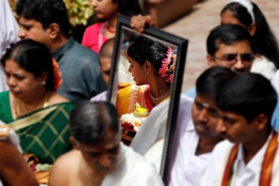 Holding the mirror for the bride to capture her reflection