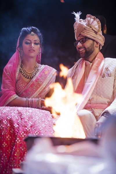A stunning picture of the bride and groom during their wedding rituals.