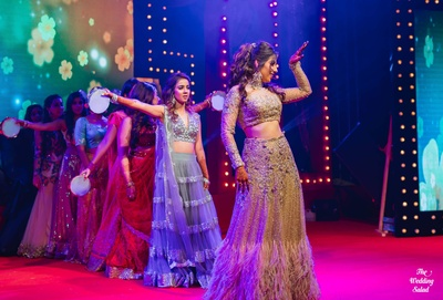 Bride and bridesmaids dancing together at the sangeet ceremony at The Royal Elm, Karjat