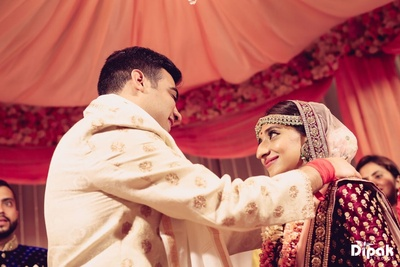 Bride and groom in a lovely shot in the Jaimala ceremony