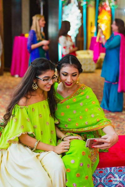Bridesmaids in quirky colors at the mehndi function at The Royal Elm