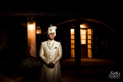 Groom portrait in his embroidered sherwani before the wedding