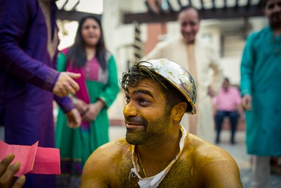 cute and quirky groom during the haldi function