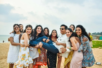Funny moment between the groom and bridesmaids at the beach mehndi function!