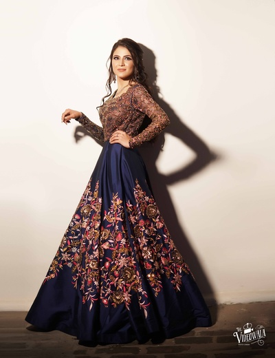 Stunning bride in a gorgeous golden and royal blue floral print gown