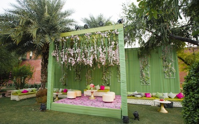 A gorgeous floral mandap with a baithak at the groom's mehendi ceremony!