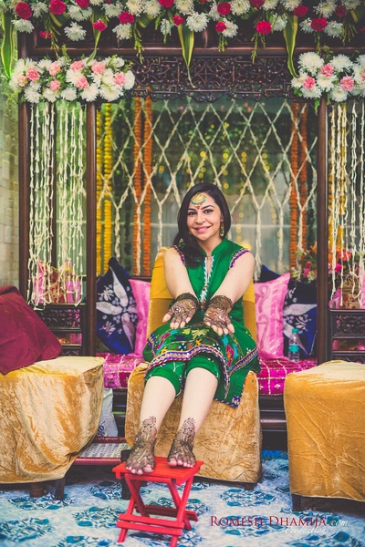 Bride Kushal showing off her beautiful intricate mehendi.
