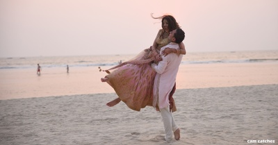 candid post wedding photography by the beach of the bride and groom