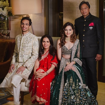 The bride and groom with Anita Dongre and Mr. Dongre posing for a family portrait