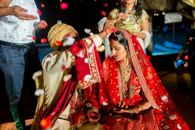 a candid capture of the bride and groom during the sindoor ceremony