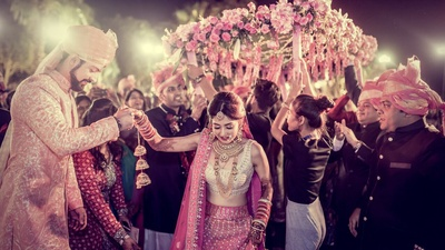 Bride enters the wedding mandap under her phoolon ki chaddar