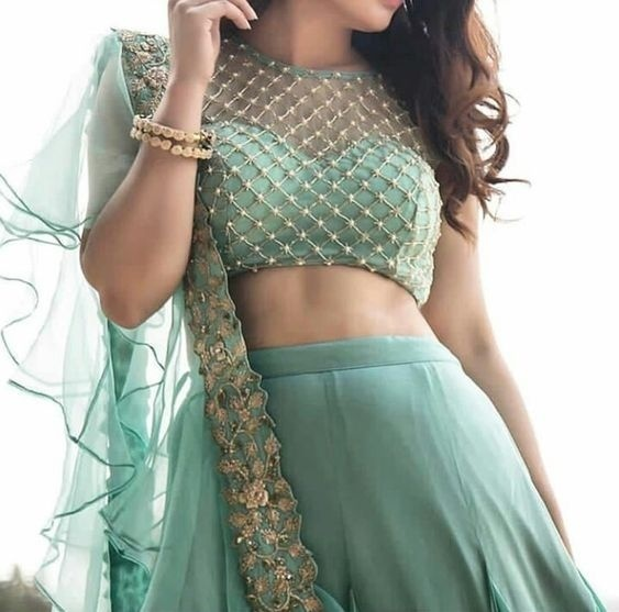 c4f712b039bd5 The sheer shoulder blouse is one of the biggest trends in bridal blouse  designs 2018. This beautiful blouse design here has a sweetheart neck  lining with ...