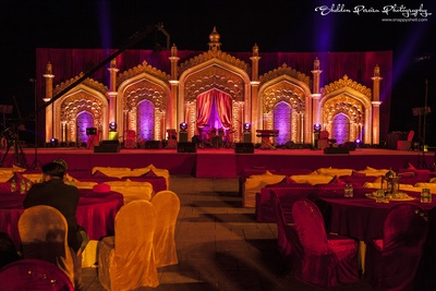Red and brown theme decor for qawwali night