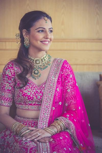 Benaisha Kharas looking beautiful in a fuschia pink gotta patti lehenga by Anita Dongre