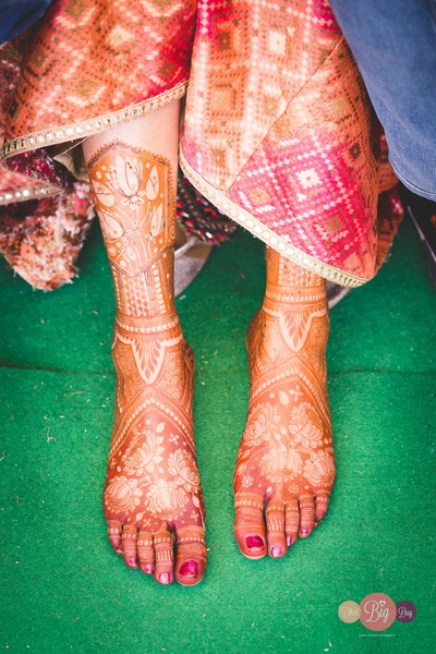 Ritika's feet adorned with her bridal mehendi.
