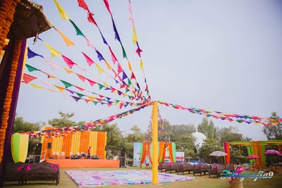 Outdoors of Jagmandir, Udaipur decorated with colorful tri angular flags, drapes and ethnic umbrellas
