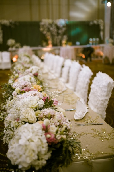 Table centerpiece and seating decor for the reception
