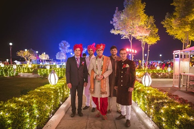 The wedding venue brightly lit up with series lights for the wedding celebrations