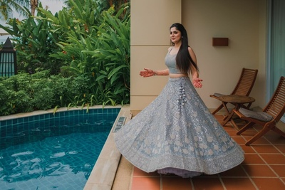 The bride twirling in a ash lehenga