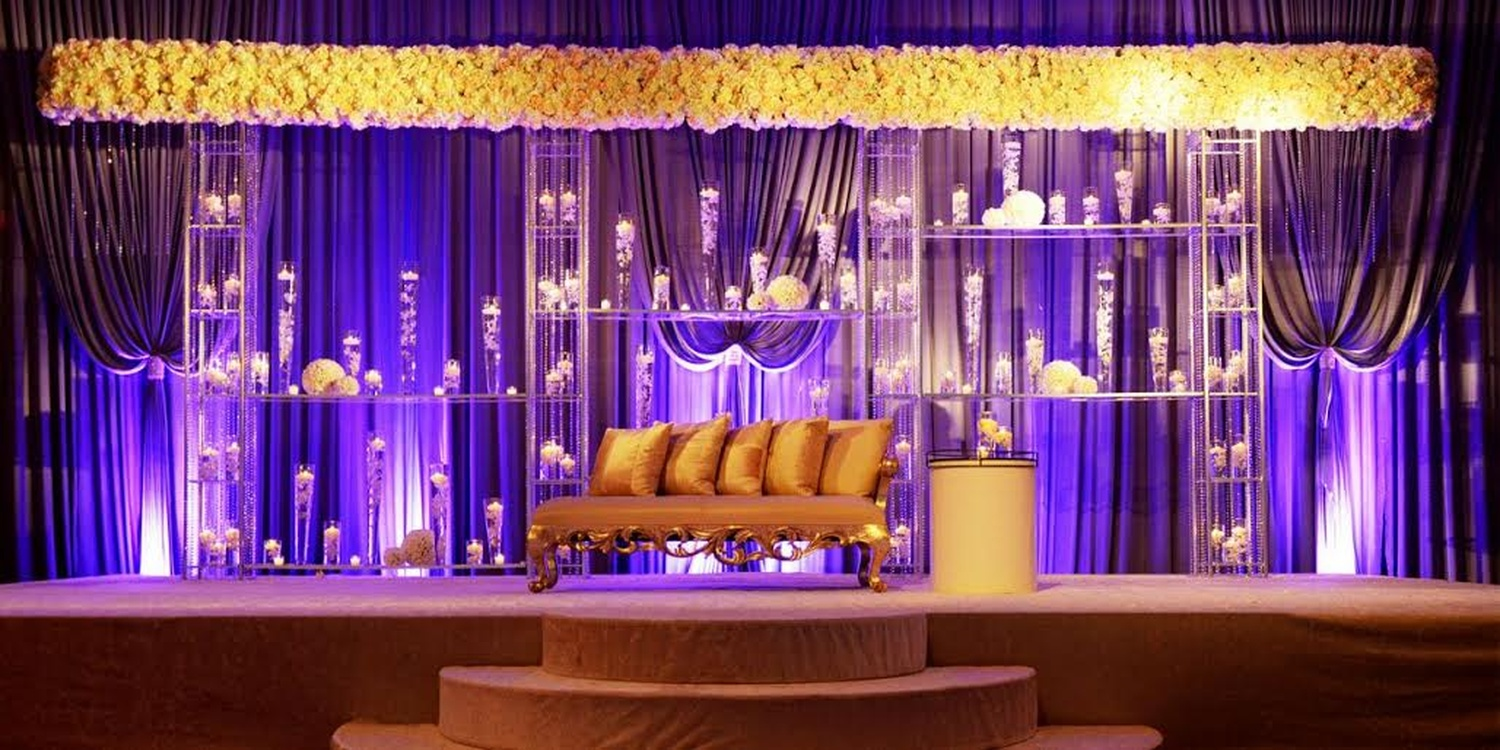 Yellow, Gold and candles for a stage decoration | Function Mania | #Trending: How to use hues of Ultraviolet for a chic wedding decor!