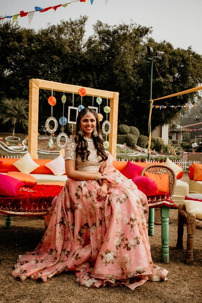 Pragya went for a floral look for her Mehendi ceremony, pairing a white crochet crop top with a baby pink floral lehenga skirt and matching dupatta.