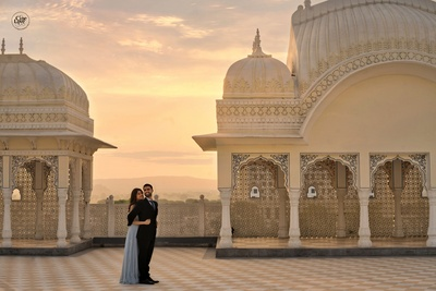 Orange-hued skies, intricate architecture and a couple in love...