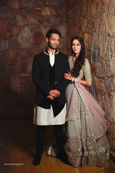 Bride and groom posing romantically at their sangeet
