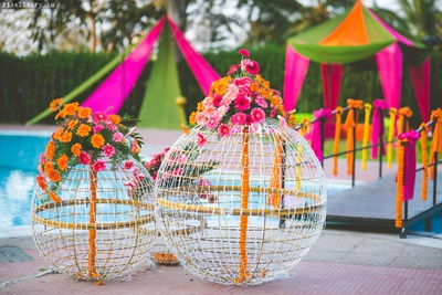 Wedding decor with fairy lights and flowers for the mehendi ceremony
