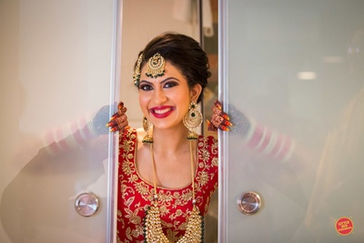 Bride posing while getting ready for her wedding