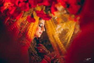 Bridal entry in a palanquin into the main wedding mandap