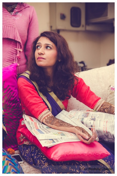 Dressed in a combination of red and blue suit for the mehendi ceremony
