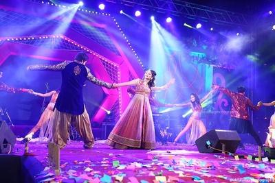 Sangeet ceremony peformances in layerd anarkali lehenga