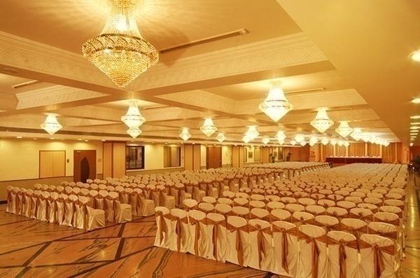 back to back chandelier arrangement in a wedding banquet hall