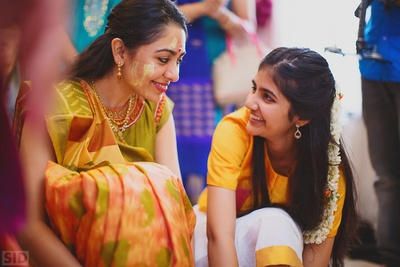 Meha and her sister's candid moment captured in between haldi ceremony.