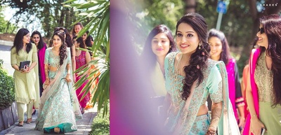 Dressed up in a pastel blue and peach lehenga for her mehndi ceremony .