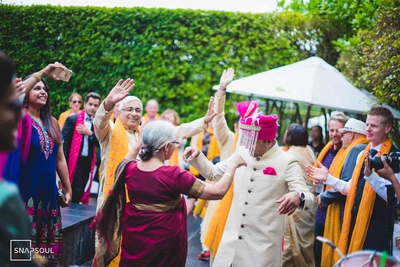 The groom dancing with family and friends at his baraat.
