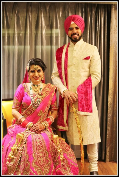 Rose pink wedding lehenga embellished with embroidered motifs, styled with a matching dupatta and choli