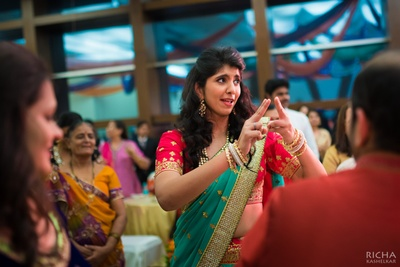 Dressed in a aqua and red lehenga with kundan jewellery. She chooses comfort over vanity!
