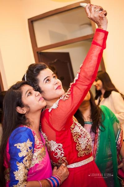 Baaratis enjoying the celebrations with wedding selfie