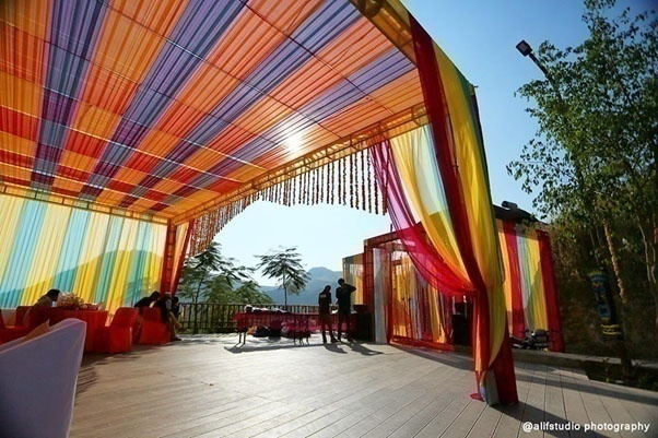 Outdoor wedding venue with colourful drapes