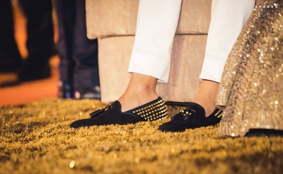 Wearing black studded loafers for the wedding reception.