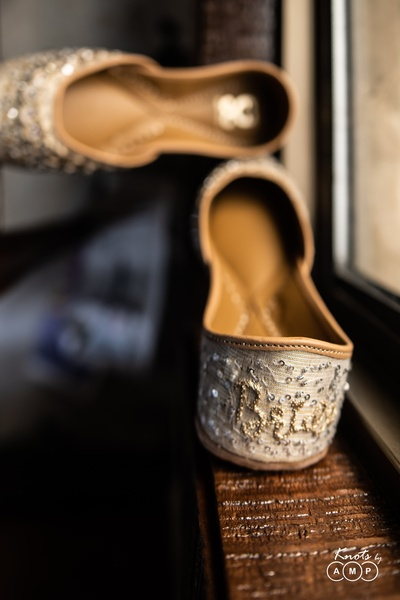 Personalized juttis with 'Bride' embroidered at the back.