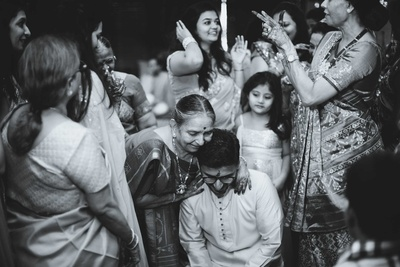 Black and White portrait of a candid click between the groom and his family