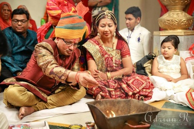 Bold multicolour mettalic banarsi kurta teamed up with a copper brown nehru jacket, gold churidar and polychromatic safa