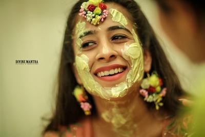 happy picture of the bride smeared in haldi